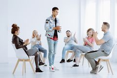 Young people clapping after performance royalty free stock photography