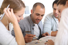 Young people in class studying together Royalty Free Stock Photo