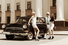 Young fashion people at the classic car Stock Image
