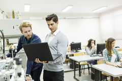 Young people in the classroom. Young people in the robotics classroom Royalty Free Stock Image