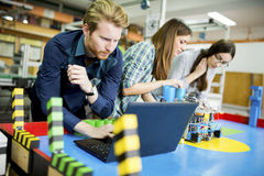 Young people in the classroom Stock Images