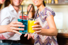 Young people with cocktails in bar Stock Image