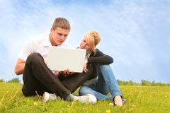 Young people and computer Royalty Free Stock Image