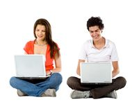 Young people with computers Royalty Free Stock Photo