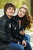 Young people in conflict relationship. Conflict and stress in young people couple relationship outdoors. Grining men and sad girl Stock Images