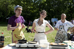 Young people cooking pancakes Stock Photos
