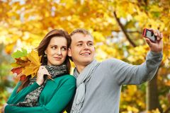 Young people Couple at autumn outdoors Stock Images