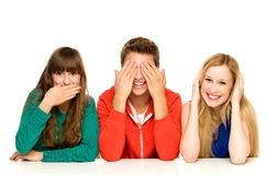 Young people covering their mouths eyes and ears. Three young people over white background Stock Photos