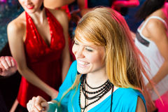 Young people dancing in club or disco, men and women. Young people dancing in club or disco, the girls and boys having fun Stock Photography