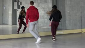 Young people dancing hip hop at studio. Skillful teenagers practicing dance moves stock video