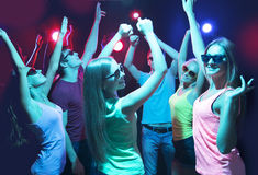 Young people dancing in a nightclub Stock Photos