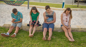 Young people with digital devices royalty free stock image