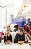 Young people in diner Royalty Free Stock Images