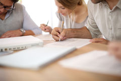 Young people doing administration together Royalty Free Stock Images