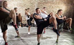 Young people doing exercise Royalty Free Stock Photography