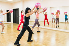 Young people doing exercises in the gym Royalty Free Stock Images
