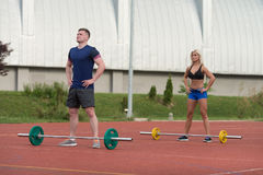 Young People Doing A Overhead Squat Exercise Outdoor Royalty Free Stock Images