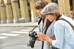 Young people doing photo reportage in town Royalty Free Stock Photography