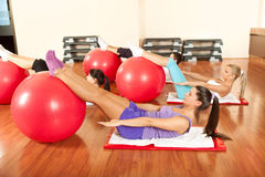 Young people doing Pilates exercises Stock Photos