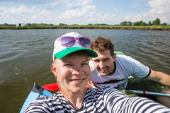 Young people doing selfie during kayaking on river in beautiful nature Stock Photo