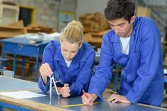 Young people doing technical drawing. Technical stock photo