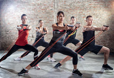 Young people doing workout with elastic band Royalty Free Stock Image