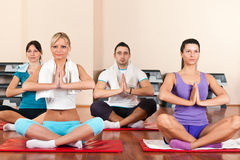 Young  people doing yoga Stock Images