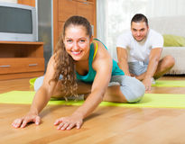 Young people doing yoga indoor Stock Photography
