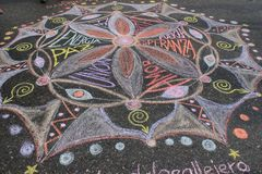 Young people drawing mandala for love and peace in the streets of Caracas during Venezuela blackout. Caracas/Venezuela -11 March, 2019: Young people drawing stock image