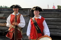 Young people dressed in period costume reenacting typical soldier's life, Fort William Henry,Lake George,2015 Stock Photography