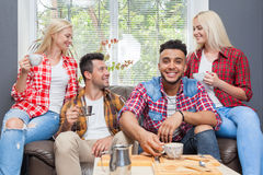Young people drink coffee shop, friends sitting table smiling Stock Images