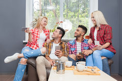Young people drink coffee shop, friends sitting table smiling Royalty Free Stock Photo