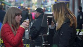 Young people drink Guiness and Cider in the streets of Galway - GALWAY, IRELAND - MAY 11, 2019. Young people drink Guiness and Cider in the streets of Galway stock video