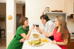 Young people drink wine Royalty Free Stock Photo