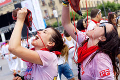 Young people drink wine, San Fermin Stock Images