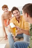 Young people drinking beer Stock Image