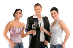 Young people drinking champagne Royalty Free Stock Photos