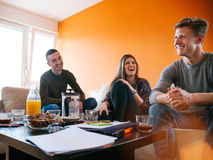Young People. Drinking Coffee In The Living Room Royalty Free Stock Images