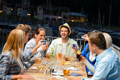 Young people doing shots at outside bar. Young people drinking shots at outside bar night out Stock Image