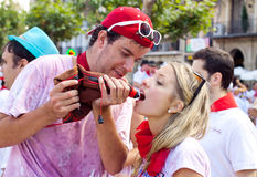 Young people drinking wine at opening of San Fermi Stock Photography