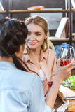 Young people drinking wine. Young people partying, drinking wine at home party Royalty Free Stock Image