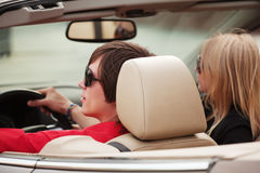 Young people driving a car Royalty Free Stock Photo