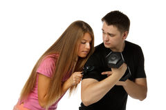 Young people with dumbbells. Stock Photography