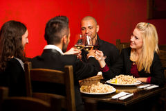 Young people eat sea food dinner at restaurant and drink wine Stock Photos