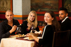Young people eat sea food dinner at restaurant and drink wine. Young people eat dinner at restaurant royalty free stock image