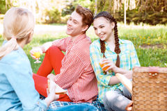 Young people eating and drinking during picnic Stock Images