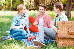 Young people eating and drinking during picnic Stock Photo