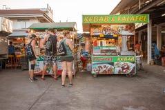 Young people eating kebab and falafel at thai nightmarket. Teens eating at Nightmarket, Thongsala, Koh Pangan Royalty Free Stock Photo
