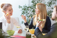 Young people eating lunch in office Royalty Free Stock Photography