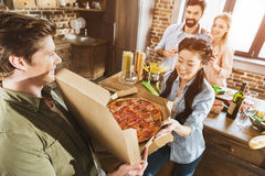 Young people eating pizza Stock Photos